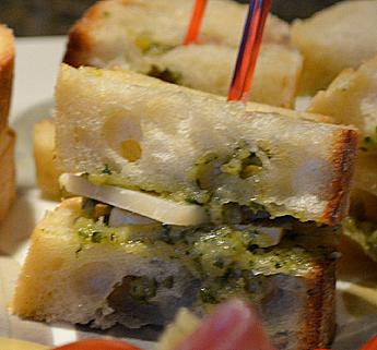Simple Cheese Bites Grana Padano, Classic Pesto on French bread.