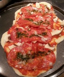 Calabrese Pizza with Pesto drops